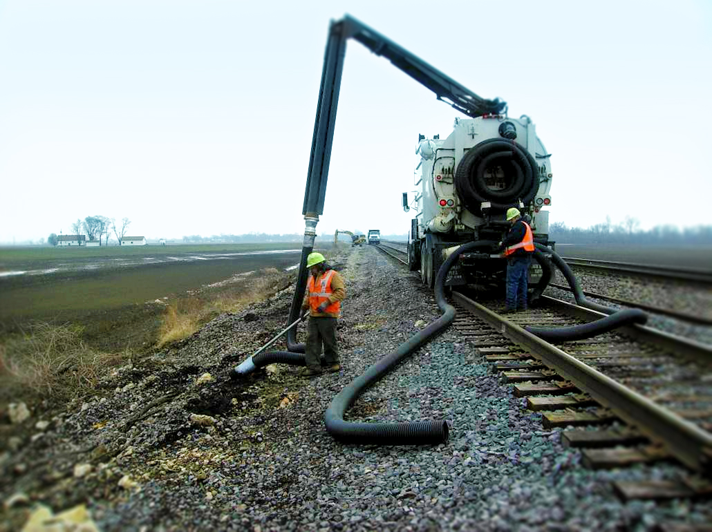 Waste disposal by vacuum truck operating along rail tracks