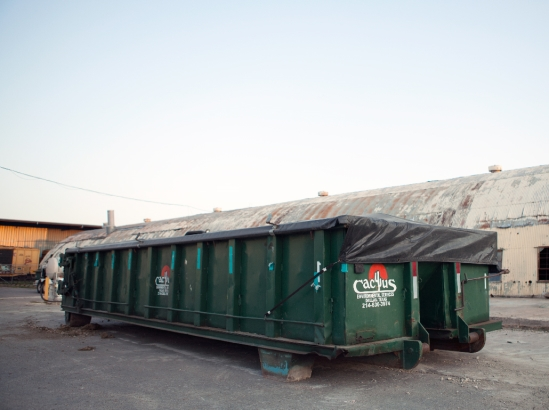 Cactus Environmental roll off container in industrial worksite